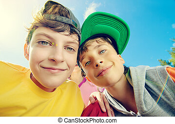in park - Two joyful boys looking at the camera against the...