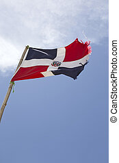 dominican republic flag over blue sky