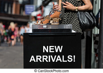 New Arrivals sign - A new arrivals sign outside a footwear...