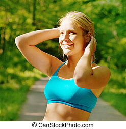 Young Woman Working Out - Young woman working out on a...