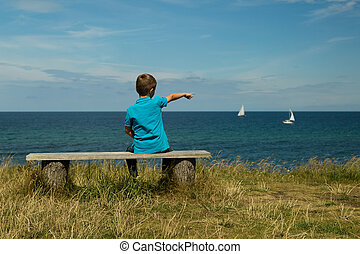 Young boy - Young caucasian boy in Denmark on a summer day.