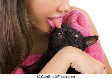 Woman licking Cute black soggy cat after a bath - Woman...