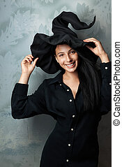 cheerful girl in witch costume smiling - beautiful cheerful...