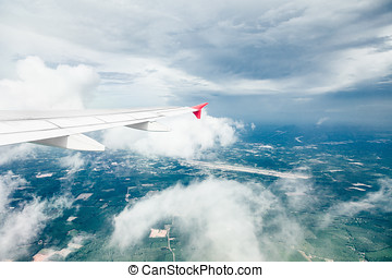 Airliner flying over clouds