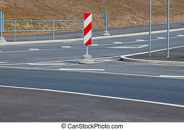 Red and white striped road signs - Red and white striped...