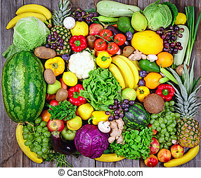 Huge group of fresh vegetables and fruit on wooden...