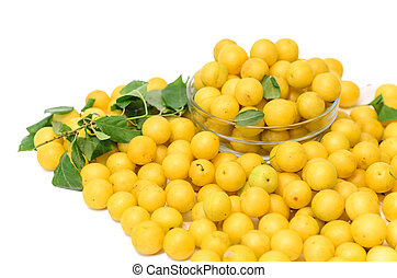 yellow mirabelle plums isolated on white background