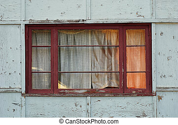 Worn Windows - Window in a dilapidated building
