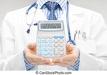 Doctor holdling in his hand calculator - studio shoot -...