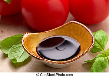 Balsamic vinegar - Bowl of Balsamic vinegar and basil leaves