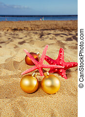 christmas balls with starfish on beach