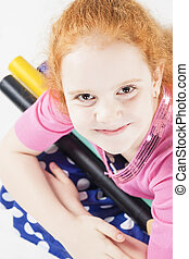 Cute and Happy Red-haired Caucasain Girl Holding Long and...