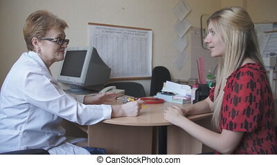 Medical doctor and patient - Doctors office conducts a...