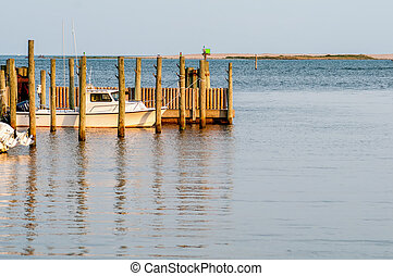 boats in the marina at sunrise at cap hatteras island