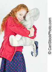 Happy Little Girl with Red Hair Playing with Big Toy - Happy...