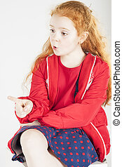 Pointing Little Red-haired Caucasain Girl with Surprised...