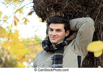 Young smiling man portrait - Young smiling man portrait in...