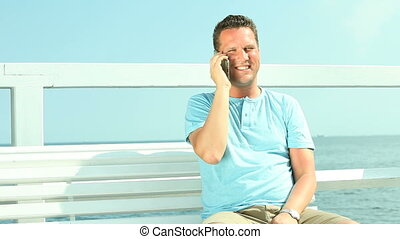 Happy man talking with smartphone