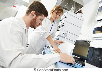 Scientist researcher man works in laboratory - researchers...