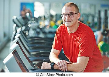 bodybuilder fitness man coach - Smiling athlete bodybuilder...