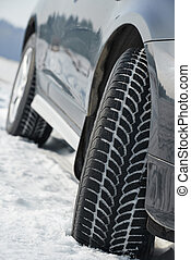Winter tyres wheels installed on suv car outdoors - Car with...