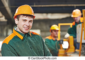 happy electrician engineer worker - Happy young adult...