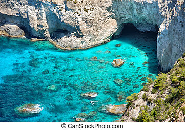 rocky beach - Panoramic view of Kryfo beach and caves in...