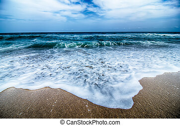 seascape with waves and sand beach scenery