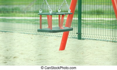 Empty swing on playground. Full HD with motorized slider....
