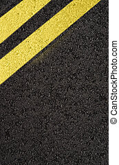 Asphalt road with yellow marking lines