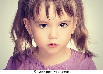 little beautiful girl with sad eyes - face of a little...