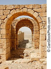 Converging ancient stone arches - Converging ancient yellow...