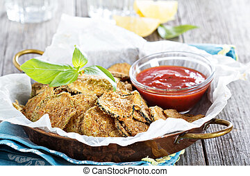 Homemade zucchini chips with breadcrumbs and parmesan
