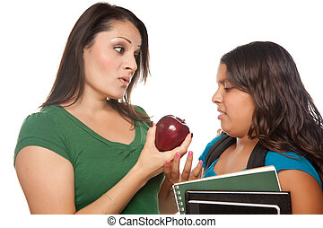 Hispanic Mother and Daughter with Books and Apple Ready for School Isolated on a White Background.