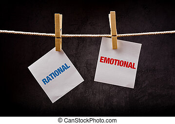 Rational vs Emotional concept. Words printed on note paper...