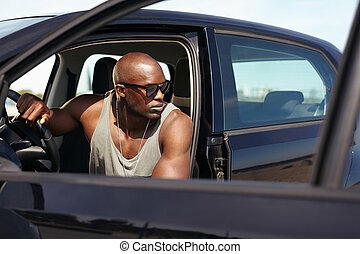 Muscular man on road trip - Image of handsome young man...