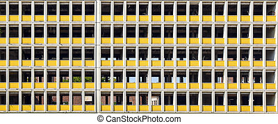 facade of a gutted office building ready for demolition
