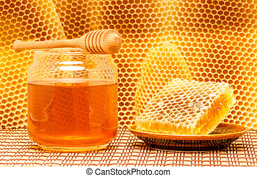 Honey in jar with dipper and honeycomb on mat - Honey in...