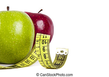 healthy diet - apple with tape measure, concept of healthy...