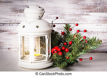Cristmas lantern with fir and berries over shabby wooden...