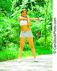 Woman Runner In The Woods - Woman runner exercising, from a...