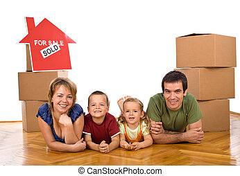 Happy family in their newly bought house