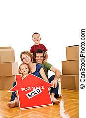 Happy family moving into a new home - Happy family on the...