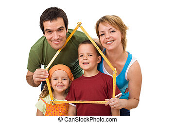Happy family with their kids - real estate concept - Happy...