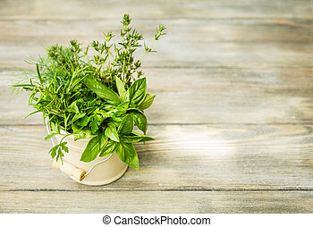Fresh herbs outdoor on the wooden table