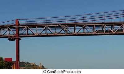 Train on the Lower Level 25 de Abril Bridge in Lisbon -...