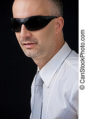 Senior manager wearing goggles