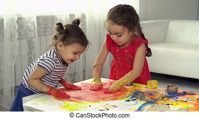 Cool and Fun - Two little girls having fun with gouache