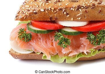 sandwich with salmon and vegetables macro isolated on white...