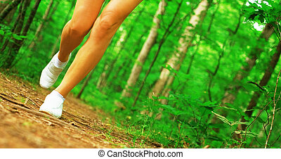 Runner Legs - Blonde haired woman exercising, from a...